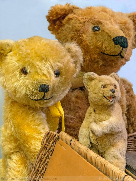 Three traditional brown furry teddy bears