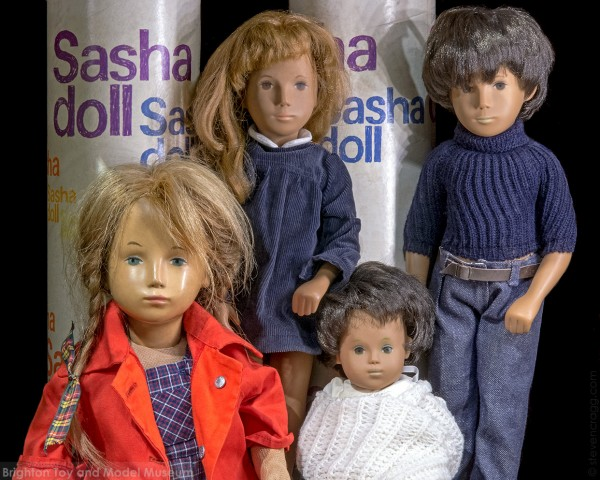Four plastic dolls in 1960's fashion