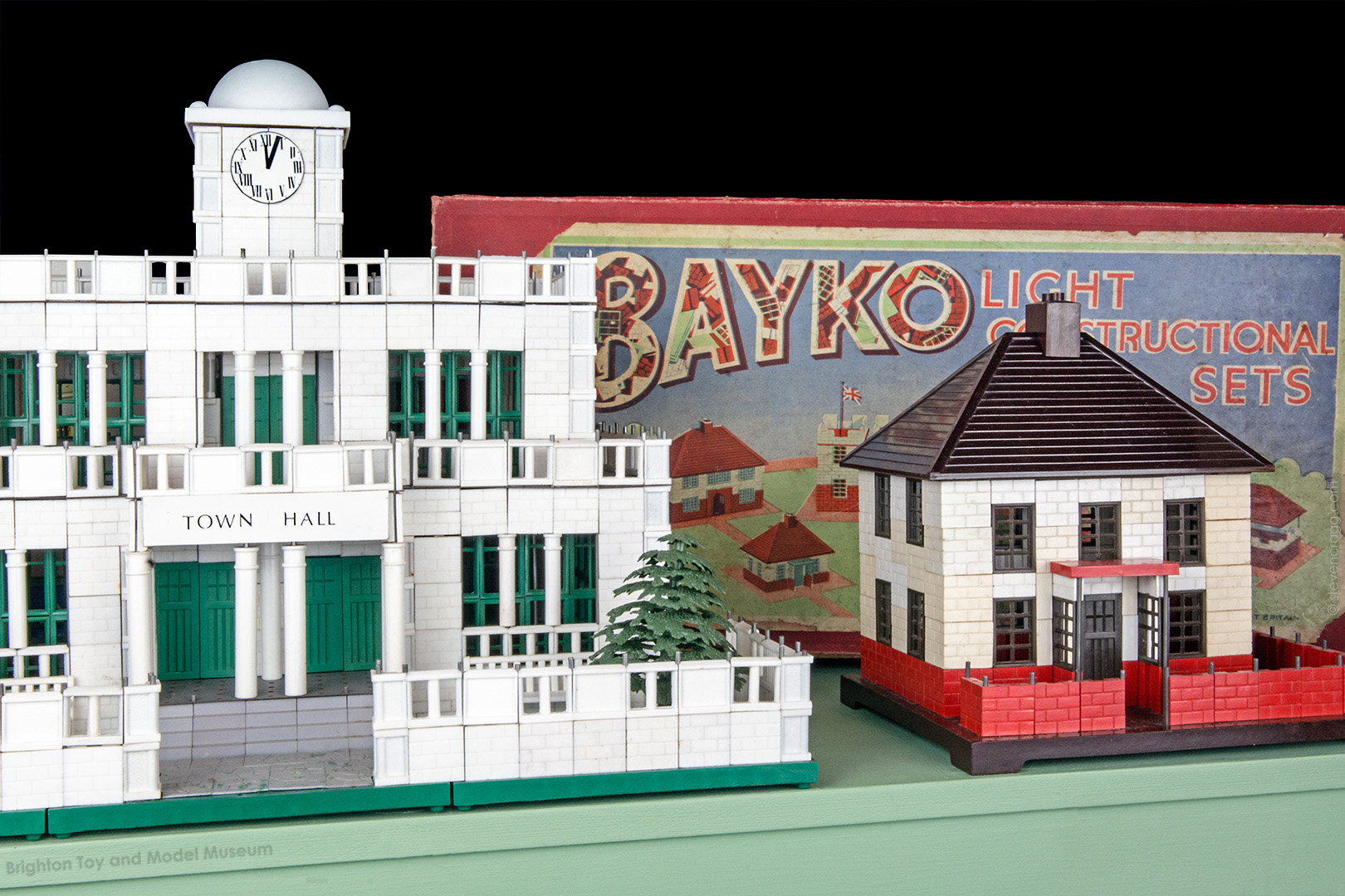 Town hall and house built out of Bayko with a vintage Bayko box sitting behind