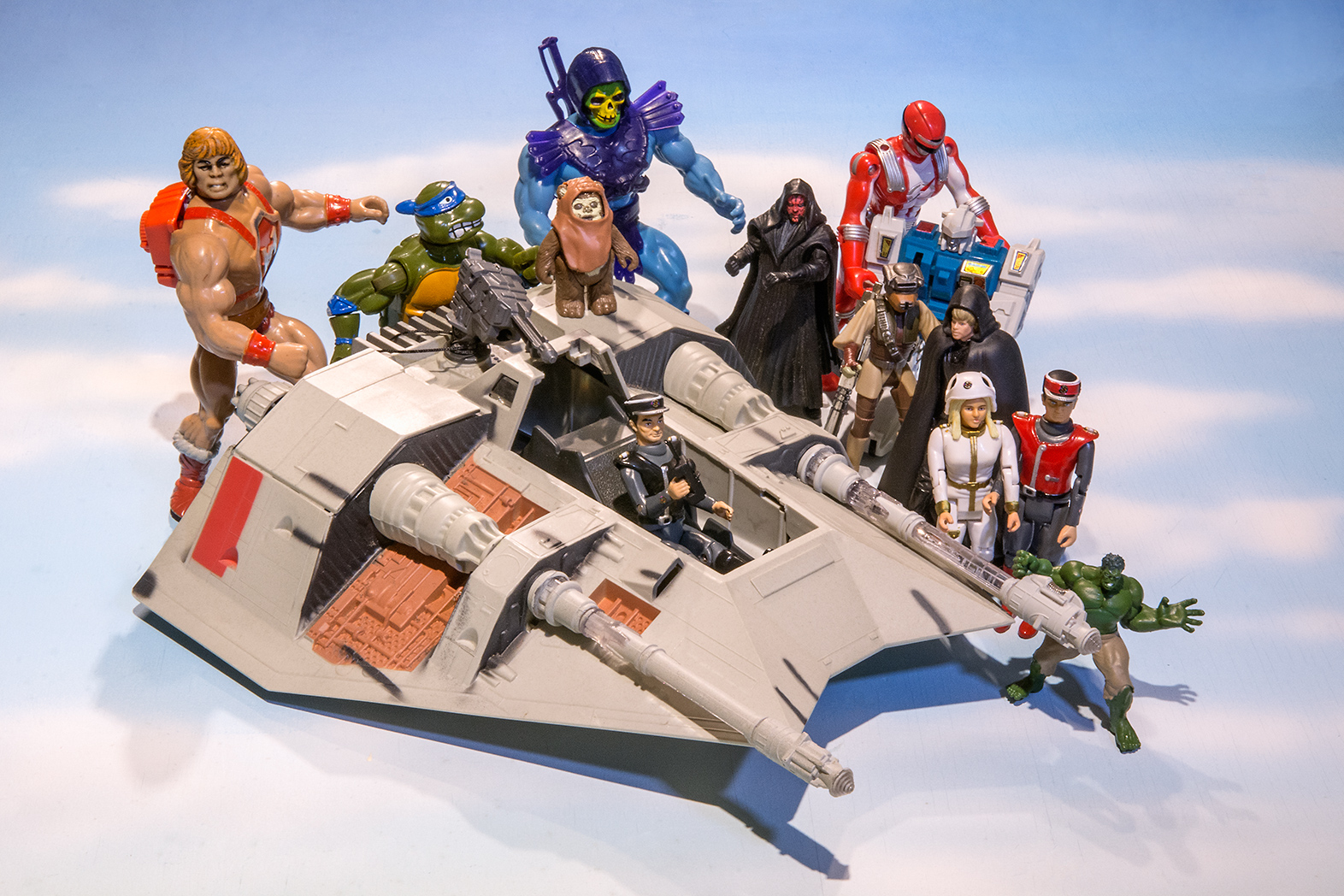 Scene of various action men including He-Man, The Hulk, Captain Scarlett, Characters from Star Wars and a Teenage Mutant Ninja Turtle