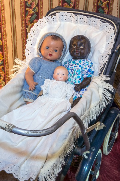 Vintage pram with three baby dolls