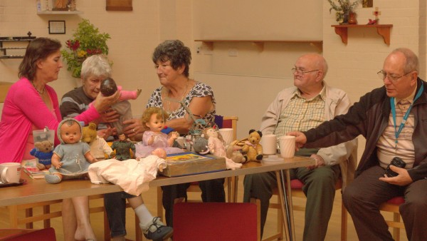 Members of the Hangleton 50+ group discussing their memories of teddy bears, dolls and construction toys.