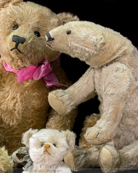 Felt bears - one light brown with a pink ribbon around its neck, one polar bear - slightly worn, one smaller white bear with a blue ribbon