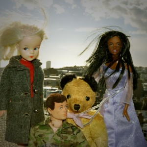 Shot of a Sindy doll, a black barbie, a Sooty bear and an action man